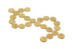 Le monete hanno organizzato nel segno del dollaro fotografia stock