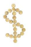 Le monete hanno organizzato nel segno del dollaro fotografie stock libere da diritti