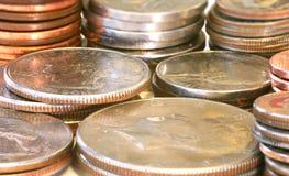 Le monete in su si chiudono Fotografia Stock