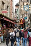 A crowd of tourists on Grand Rue, the main street in Mont Saint Michele. Normandy, France. Le Mont-Saint-Michel, France - September 13, 2018: A crowd of tourists stock photo