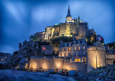 Le Mont-St-Michel. The mystical, breathtaking Mont Saint Michel is dedicated to Saint Michael, the Archangel of Light. One of the true wonders of the modern Stock Images