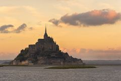 Le Mont St-Michel in Normandie. Mont saint-Michel with beautiful sunset Stock Photo
