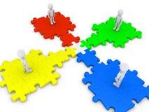 Le morceau spécial de puzzle joint quatre personnes Photographie stock libre de droits