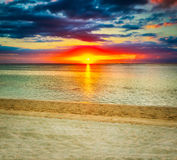 Le Morn beach at sunset. Stock Photography