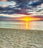 Le Morn beach at sunset. Royalty Free Stock Photography