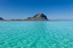Le Morne Brabant. View over the turquoise waters of the Indian Ocean towards the mountain Le Morne Brabant at Le Morne, Mauritius, Africa Royalty Free Stock Image