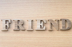 Le mot AMI de l'alphabet en bois Photos libres de droits
