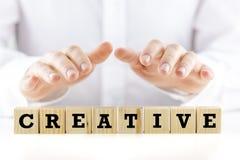 Le mot - créatif - sur les blocs en bois Photos stock