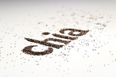 Le mot de Chia fait à partir du chia sème le hispanica de Salvia sur le fond blanc Photographie stock