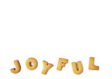 Le mot JOYEUX écrit avec l'alphabet a formé des biscuits, d'isolement sur le fond blanc avec l'espace libre pour le texte Image stock