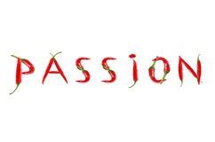 Le mot PASSION écrite avec des poivrons de piment rouge Image stock