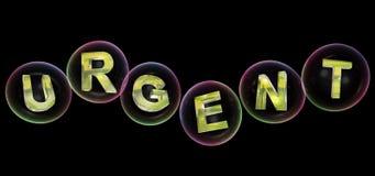 Le mot urgent dans la bulle Photos stock
