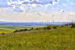 Le moulin à vent met en place la terre Photographie stock