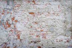 Le mur de briques reste du vieux plâtre images libres de droits