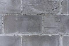 Le mur de la vieille ville, construit du fragment concret, gris, poreux, minable de texture de blocs photos libres de droits