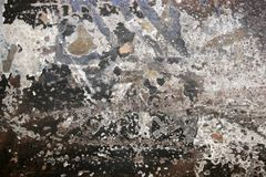 Le mur de ville peint donne au fond une consistance rugueuse de graffiti Images stock