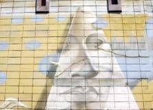 Le mur est décoré du plan rapproché abstrait de peinture pour bâtiments de dessins Détail d'un graffiti Fragment pour le fond Urb Photos stock