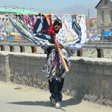 Le négociant afghan d'écharpe Images libres de droits
