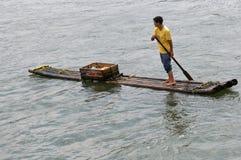 Le négociant de radeau de fleuve Image libre de droits