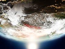 Le Népal avec le soleil sur terre de planète Photo stock