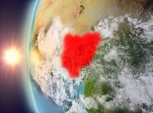 Le Nigéria pendant le coucher du soleil de l'espace Image libre de droits