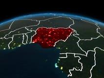 Le Nigéria sur terre la nuit Photos stock