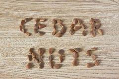 Le noci di cedro dell'iscrizione Fotografie Stock