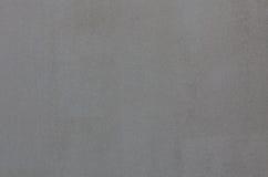 Le noir gris en pierre de fond raye le mur de textures Photographie stock