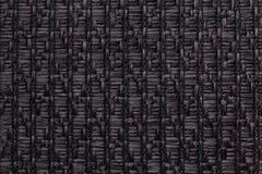 Le noir a tricoté le fond de laine avec un modèle de tissu mou et laineux Texture de plan rapproché de textile Image stock