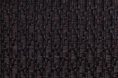 Le noir a tricoté le fond de laine avec un modèle de tissu mou et laineux Texture de plan rapproché de textile Photographie stock libre de droits