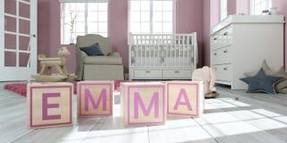 Le nom Emma écrite avec les cubes en bois en jouet chez la pièce du ` s des enfants Image libre de droits