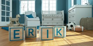 Le nom Erik écrit avec les cubes en bois en jouet chez la pièce du ` s des enfants Photos stock