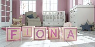 Le nom Fiona écrite avec les cubes en bois en jouet chez la pièce du ` s des enfants Images libres de droits