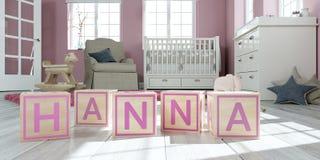 Le nom hanna écrite avec les cubes en bois en jouet chez la pièce du ` s des enfants Photo libre de droits
