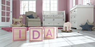 Le nom IDA écrit avec les cubes en bois en jouet chez la pièce du ` s des enfants Images libres de droits