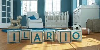 Le nom Ilario écrit avec les cubes en bois en jouet chez la pièce du ` s des enfants Photographie stock libre de droits