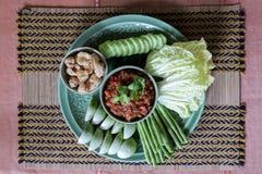 Le nom thaïlandais thaïlandais du nord d'immersion épicée de viande et de tomate est prik de Nam image libre de droits