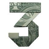 Le nombre du CHIFFRE 3 d'origami d'argent s'est plié avec le vrai un dollar Bill Isolated sur le blanc photographie stock libre de droits