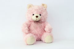 Le nounours rose concernent un fond blanc Photo stock