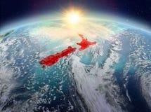 Le Nouvelle-Zélande de l'espace dans le lever de soleil Images libres de droits