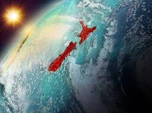 Le Nouvelle-Zélande sur terre de planète dans le coucher du soleil Photo libre de droits