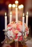Le nozze fioriscono le candele del briciolo della decorazione Fotografie Stock