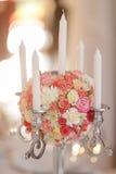 Le nozze fioriscono le candele del briciolo della decorazione Fotografia Stock