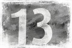 Le numéro 13 sur un mur gris Photo stock