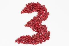 Le numéro trois, fait par les pierres rouges Photo stock