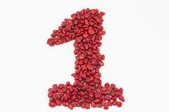 Le numéro un, fait par les pierres rouges Photos libres de droits