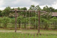 Le oscillazioni di legno sul riso hanno archivato fotografia stock libera da diritti