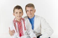 Le père étreint son fils Photographie stock