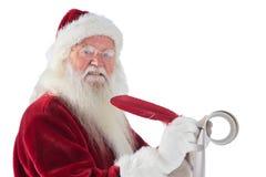 Le père Christmas écrit une liste Photographie stock libre de droits