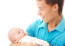 Le père heureux retient son petit enfant Photo stock